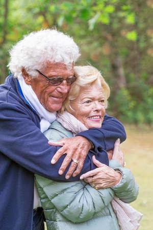 beautiful smiling senior couple enjoying life in countryside Stock Photo