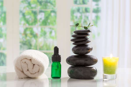 hot stones: Spa setting with hot stones, candle,ans aroma oil