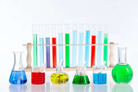 Various laboratory flasks with a colored reagents,