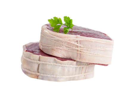 Tournedos: a small round thick cut from a fillet of beef white Stock Photo