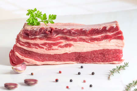Raw briskets isolated on white