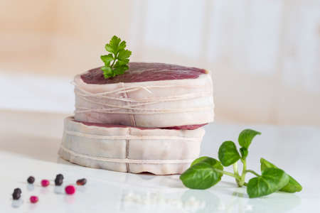 Tournedos: a small round thick cut from a fillet of beef white background Stock Photo