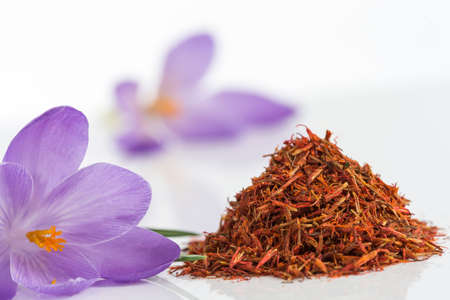 cathartic: Flower crocus and dried saffron spice on white background.