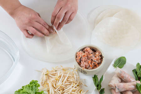 Hands preparing homemade dim-sum asian dumplings buns