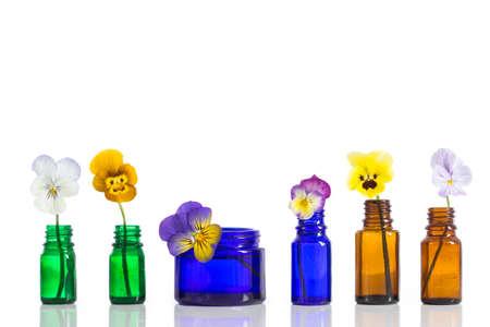 diuretic: Viola tricolor nice pansies,essential oil in bottle Stock Photo