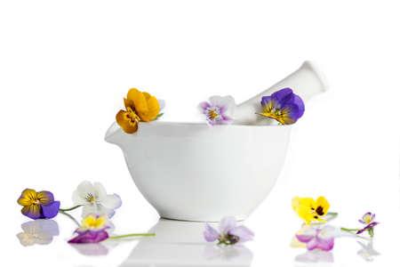 antirheumatic: Viola tricolor nice pansies ,in and outsite ceramic mortar Stock Photo