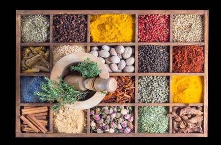 badiane: wood box with spices and herbs with fresh chive and garlic on wooden mortar