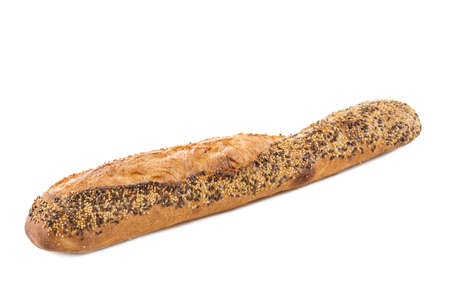 Closeup of a white baguette topped with different seeds, such as sesame and poppy seeds, on a white Foto de archivo