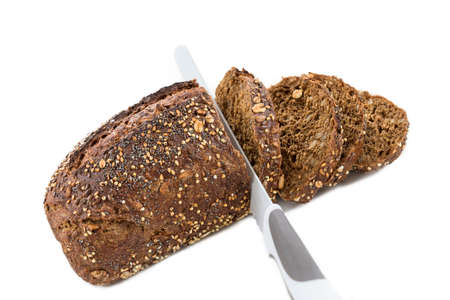linseed: Swedish bread with seeds with slice and bread knifeisolated on white background Stock Photo