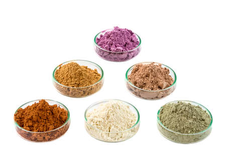 Ancient minerals - Clay of several colorsclay powder and mud mask for spa, beauty concept crop on white background