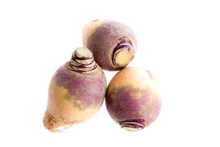 three Fresh Rutabaga root on the white
