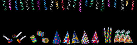 Panoramic festive image with rolls of curly ribbons hanging from top and multi party favors on the gound on black on the gound