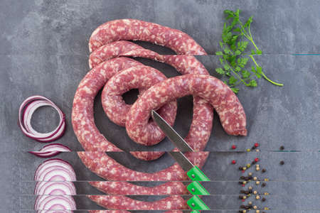 Toulouse sausage Raw saucisse de toulouse in ring french meat specialty from Toulouse on white