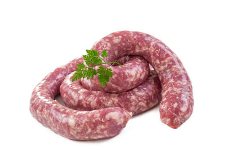 Toulouse sausage Raw saucisse de toulouse - french meat specialty from Toulouse on white Stock Photo