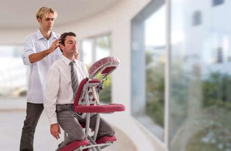 Businessman having head massage in medical large, windows, background, office Imagens