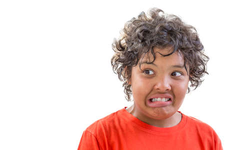 grimace of disgust. portrait of young boy grimacing of disgusty isolated on white background