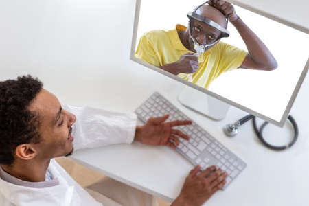 Telemedicine or telehealth concept. Doctor on computer laptop screen. assisting patient for a CPAP continuous positive air pressure assistante Stock Photo