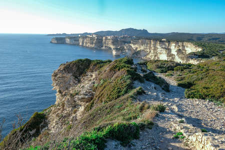 A view of the city cliff of Bonifacio, which lies directly on the rock above the sea Stock Photo