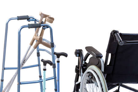 set of mobility aids including a wheelchair, walker, crutches, quad cane, and crutches. Imagens
