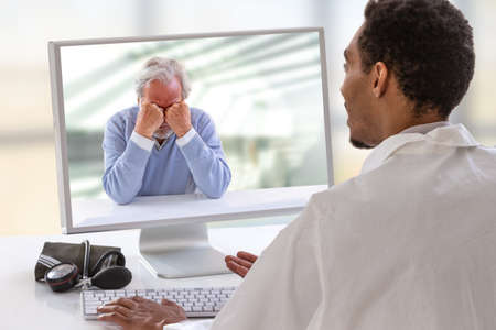 psychologist session on computer screen. Telemedicine or telehealth for a depressed senior man