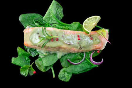 Steamed cooked salmon and vegetables, spinach, Lunch, fillets on black Banco de Imagens