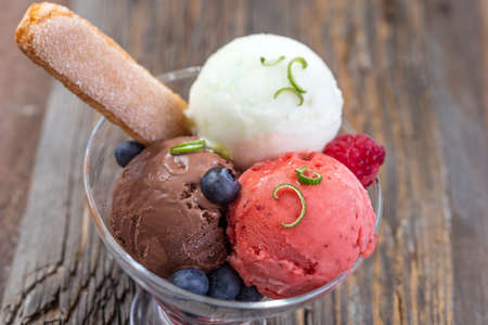 Variety of ice cream in bowls. Fresh, ice creams and sorbet.Variety