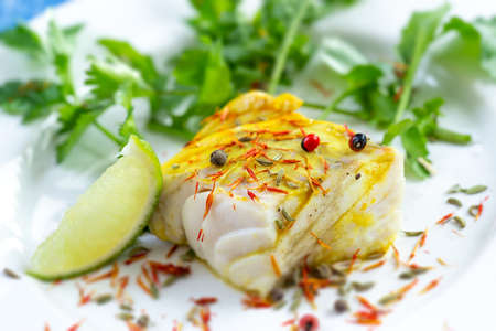 Plate of Steamed fish with saffron spice with salad Stockfoto