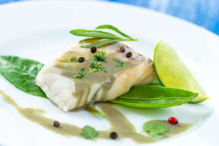 Plate of Steamed fish with sorrel sauce with salad Stockfoto