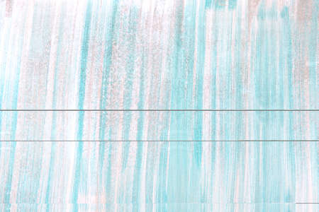 light blue acrylic painted wooden background.