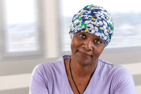 woman cancer patient wearing headscarf. Head, hope.African, American woman smiling Banco de Imagens