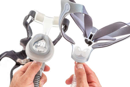 Doctor demonstrating Treatment of sleep apnea and snoring for patient suffering from Obstructive Sleep Apnea Syndrome OSAS connected to a continuous positive airway pressure device CPAP Imagens