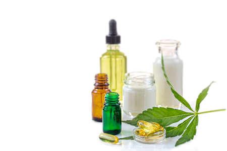 Cosmetic hemp concept Cannabis hemp bodycare procucts with marijuana leaf on whtebackground