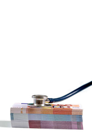 a stethoscope on a wad of euro bills, depicting the concept of the health care costs