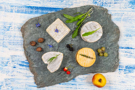 Selection of different types of cheese. Tasty and fresh cheese top view