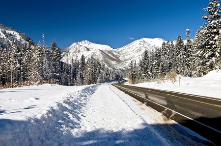 winter road: Snow Covered Mountain with Road