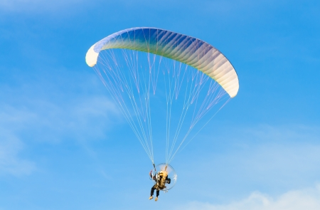 parachute: Paraglider on blue bright sky