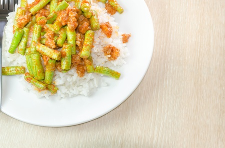 Stir fried pork and curry paste wite rice photo