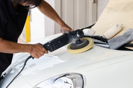 Car care with polishing machine photo