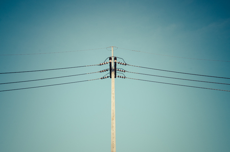 Power line on pillar, processed photo