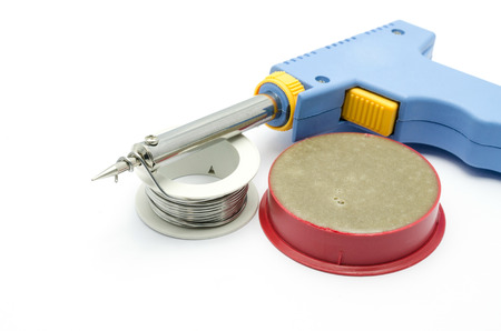 Soldering equipment containing a soldering gun and tin wire and brazing cream photo