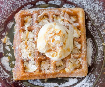 vanilla ice cream scoop on waffle with almond and honey photo