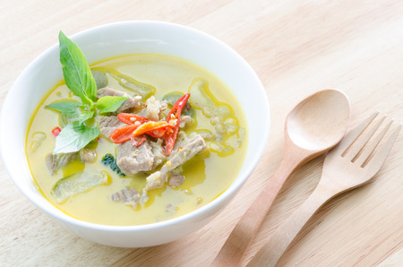 Green curry with pork   and woodden fork spoon photo