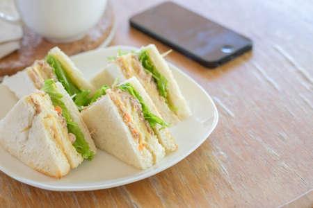 tuna mayo: Fresh made tuna sandwiches on wood table