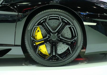 alloy: Super car disc brake. Car wheels. steel alloy car disks background Stock Photo