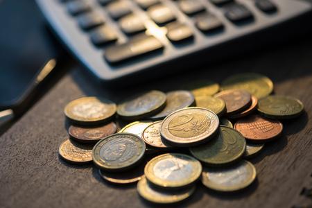 Euro coins with calculator, Money concept, close up euro coins. selective focus