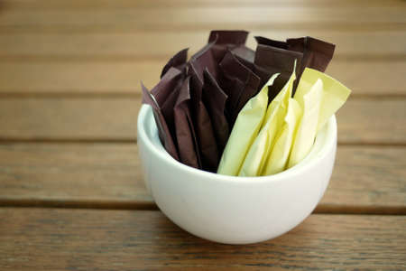 packets: brown and white sugar sticks Stock Photo