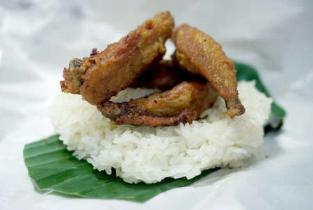 fried chicken wing on sticky rice  Stock Photo