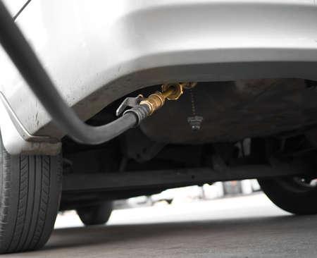 refuel: A car refuel the cheap LPG at gas station