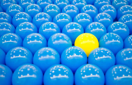 Unique yellow ball among blue balls  Able to use as background