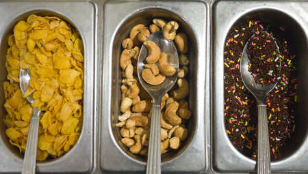 Ice cream toppings, cereals, cashew nut and chocolate rainbow